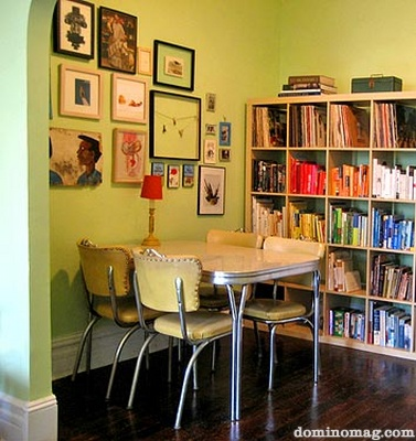 Green dining area with bookshelves